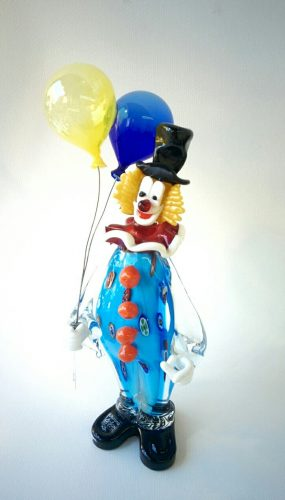 Murano Glass clown with a black hat holding balloons in his hand