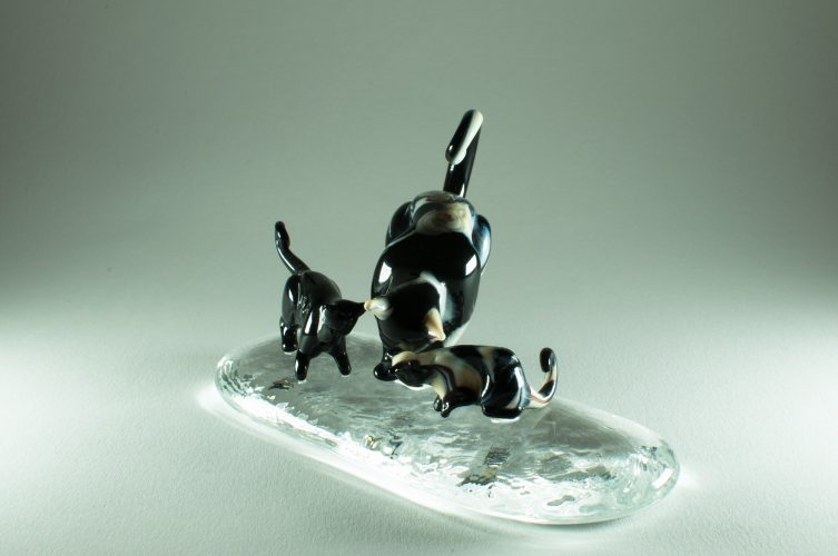 Details of a set of 3 murano glass cats