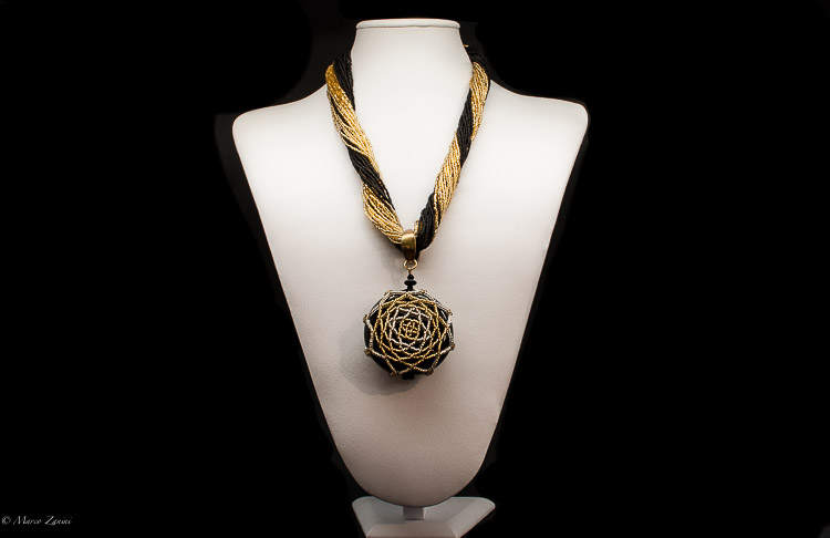 Black and Gold Necklace with conterie beads and a big central pendant