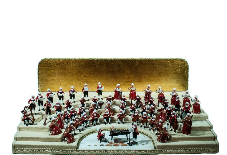 Orchestra of Murano Glass miniatures on a stage