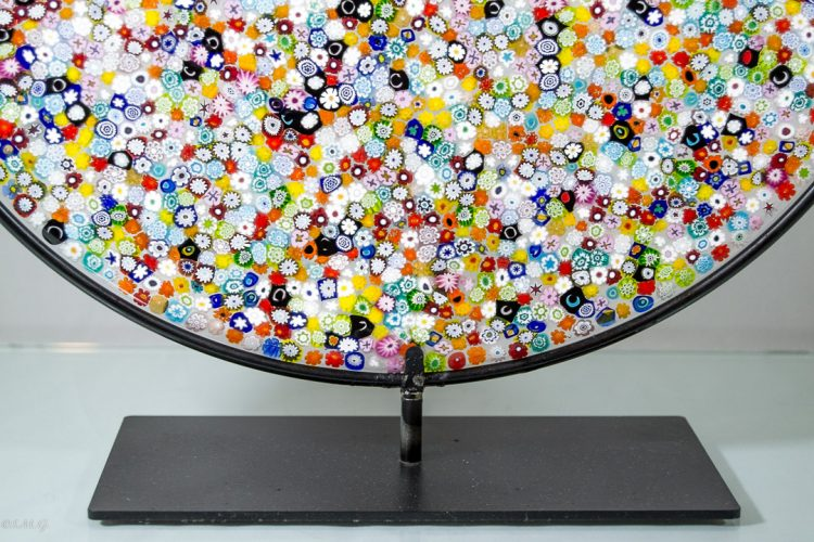 Details of Murano glass round disc on a stand