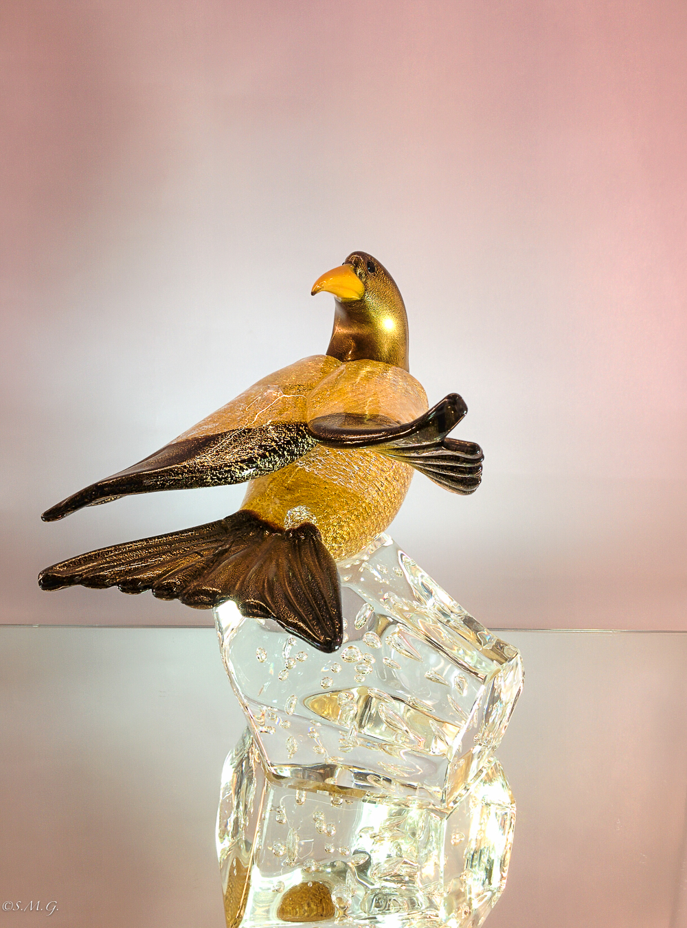 Murano Glass bird with gold on a clear base