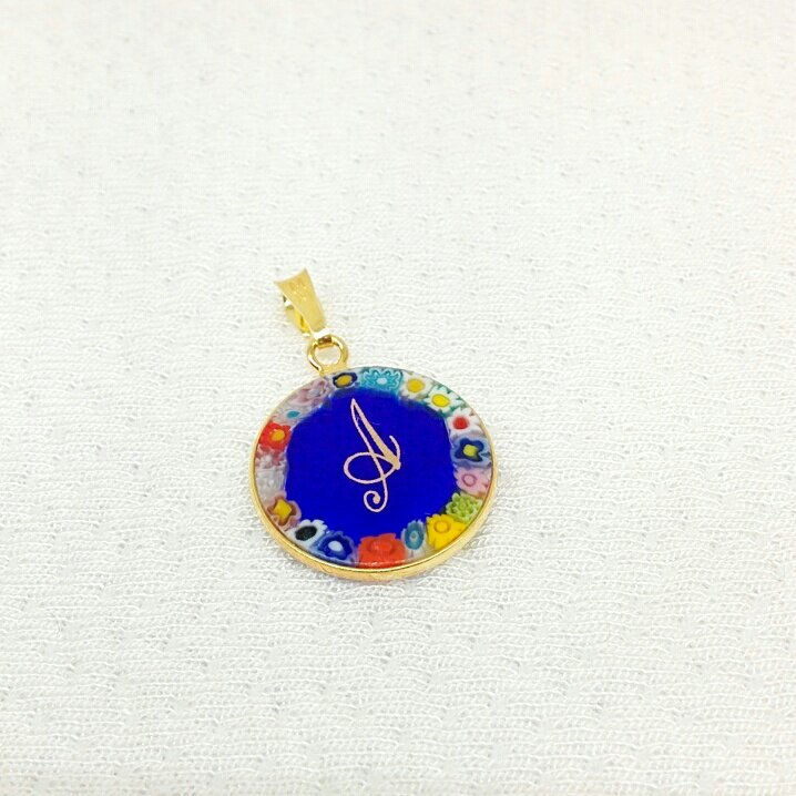 Round pendant with decal letter and Murrina