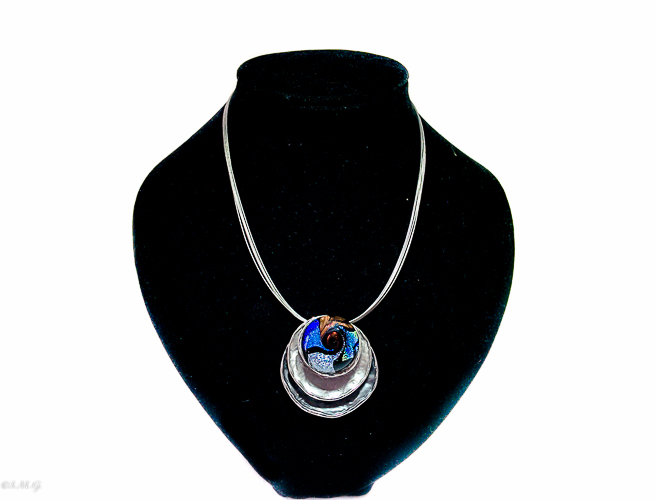 Murano glass round pendant in black and blue colour on a base