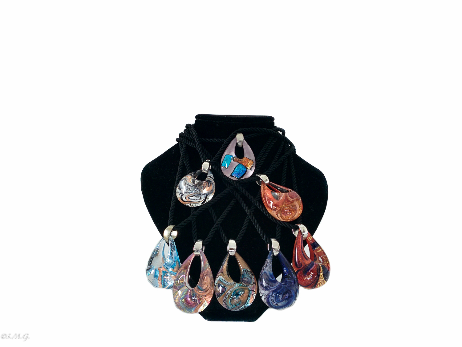 Murano glass pendants in the shape of a drop with a fabric string on a black display