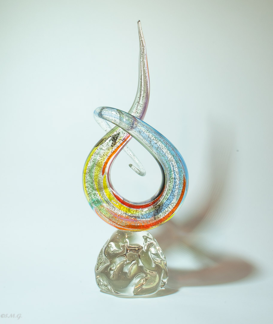 Murano Glass coloured sculpture in the shape of a knot on a base