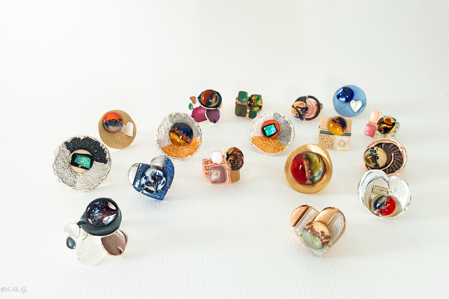 Murano Glass rings on display in a white background