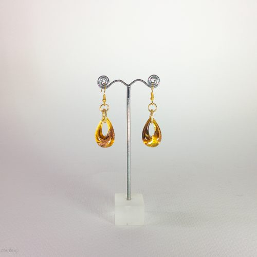 Pair of Murano glass earrings on a display