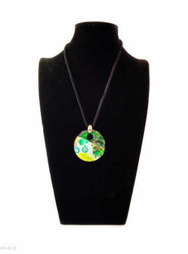 Murano glass round pendant on a black display