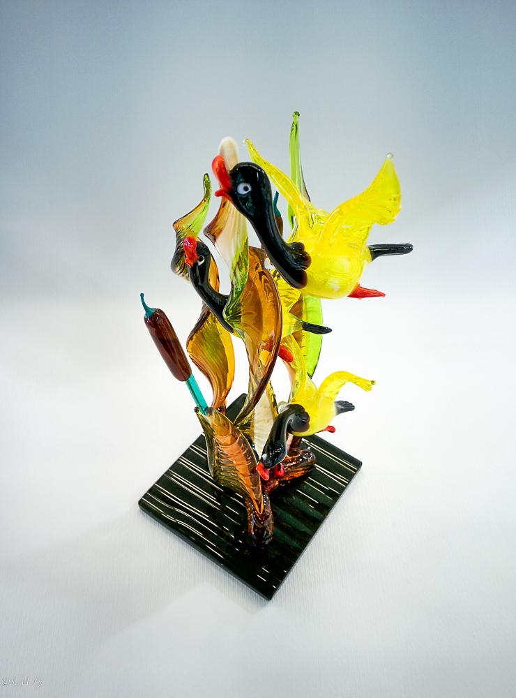 Murano glass ducks on a base