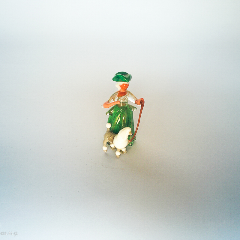 Murano glass miniature of a lady with a poodle on a leash
