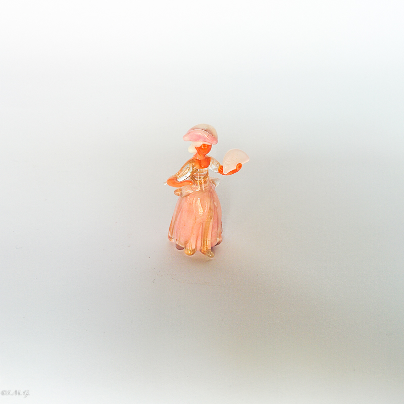 Murano glass miniature of a lady holding a fan