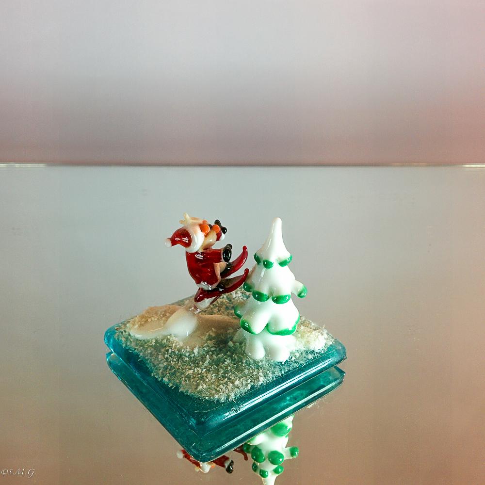 Murano Glass santa claus on a snowboard
