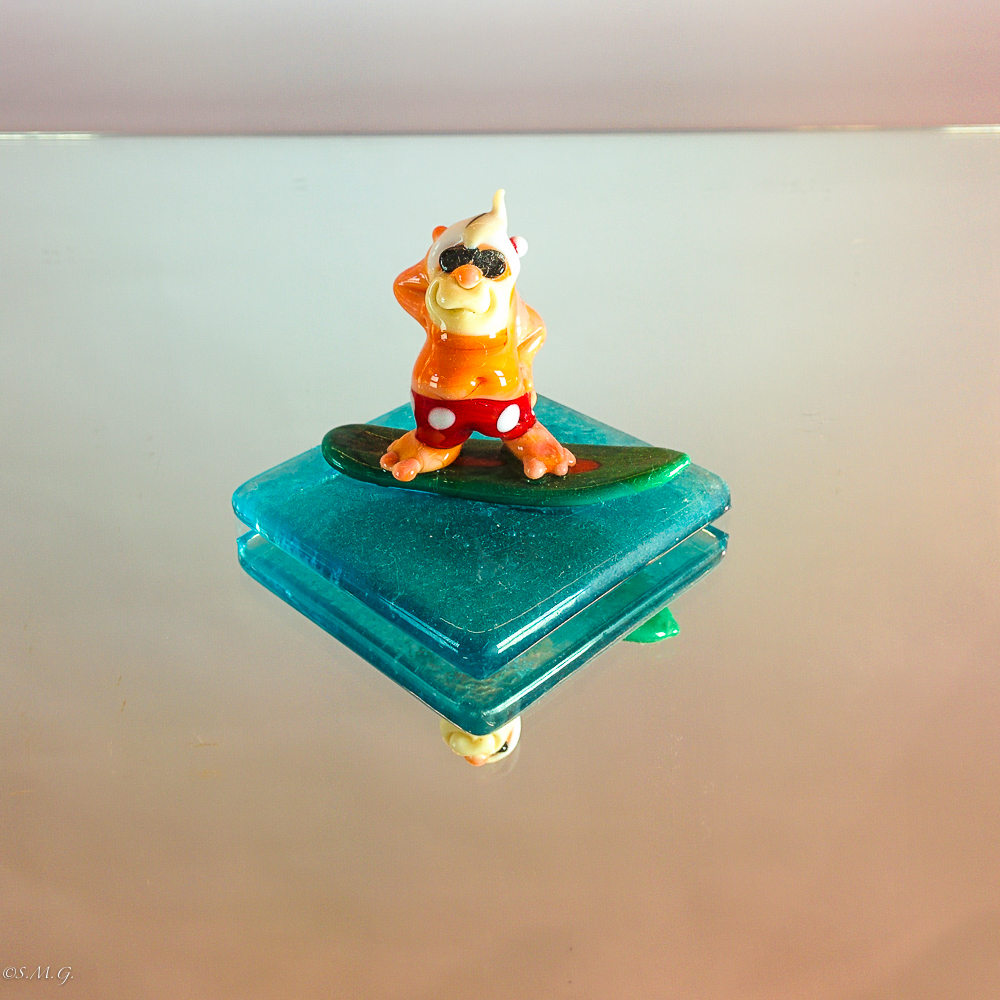 Murano Glass santa claus on a surfing board