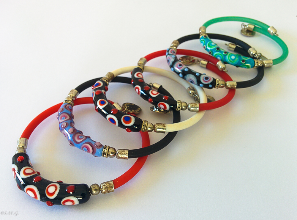 Murano glass bracelets with coloured spots on the surface