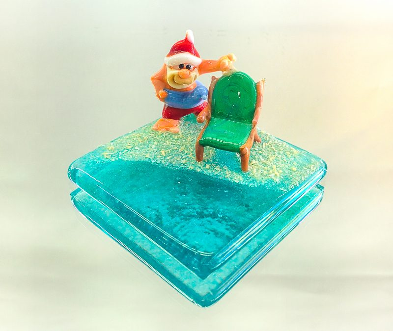 Santa Claus with a beach chair