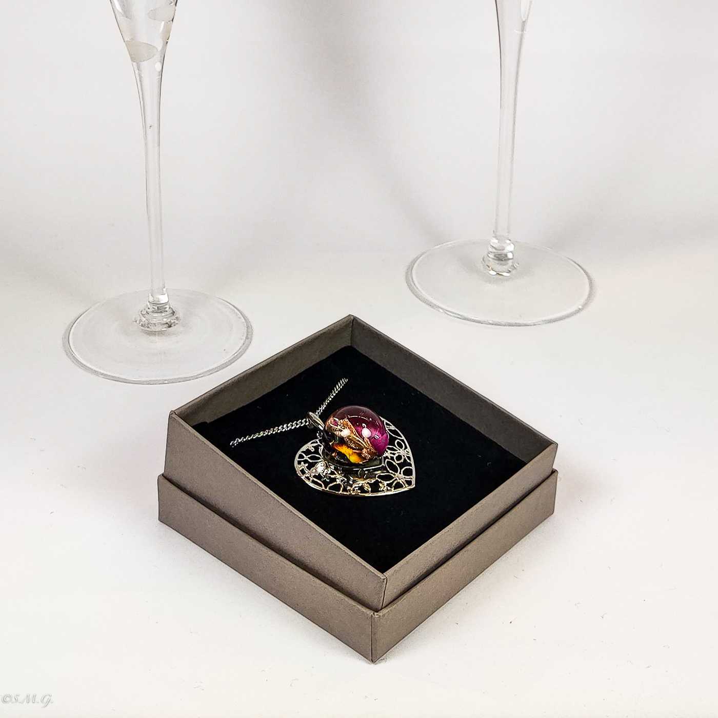 Set of 2 Murano Glass champagne flutes and a heart shaped pendant