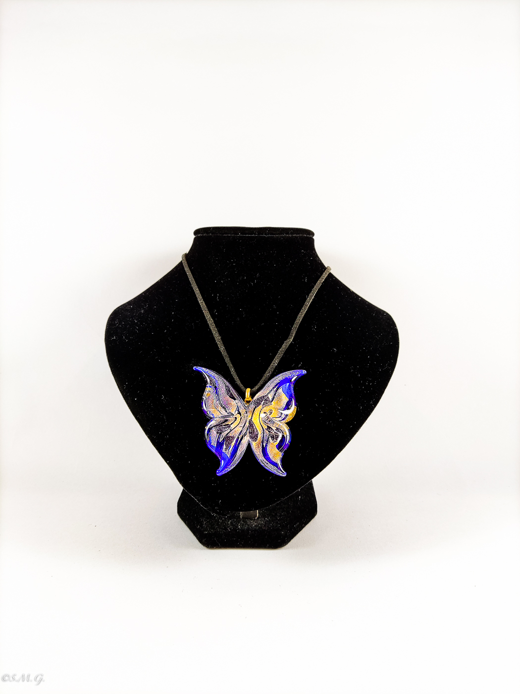 Murano Glass pendant in the shape of a butterfly on a string